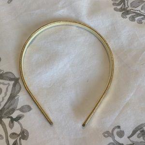 Metallic gold headband.